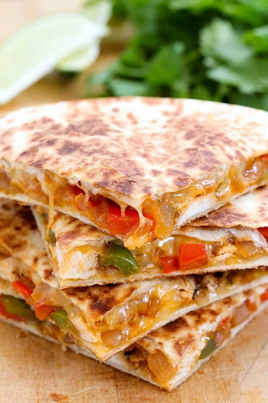 Quesadillas stacked on plate.