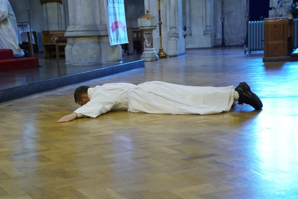 Bro Philip Mulryne OP prostrates during the litany of the Saints