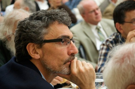 Claudio Monge listens intently during the conference.
