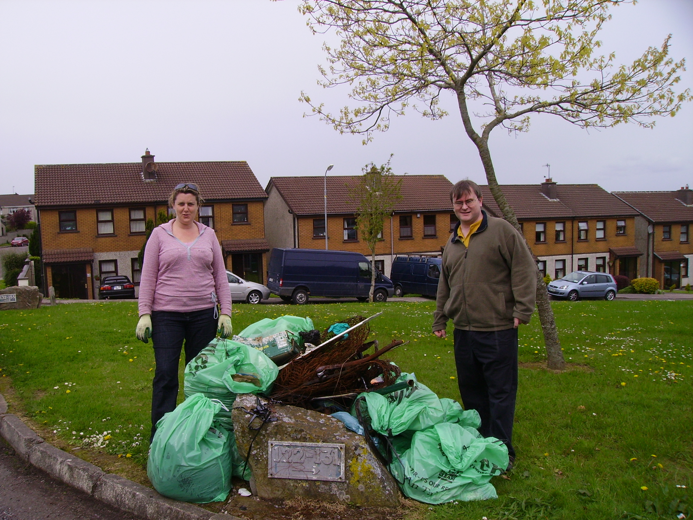 Cllr. Dominick Donnelly with Bracken Court resident Helen Maher, and the pile of rubbish collected by the residents