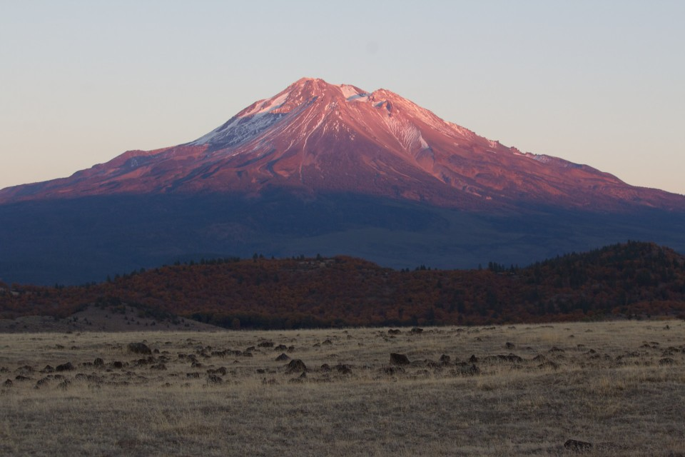 The glow of a sunset setting on Mt Shasta