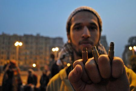 In 2011, a protestor showed bullet casings recovered from the ground following the army's attack on Tahrir Square. Photo by Ali Mustafa, CC license 4.0 BY-ND-NC.  See more of Ali's work at alimustafa84.wordpress.com