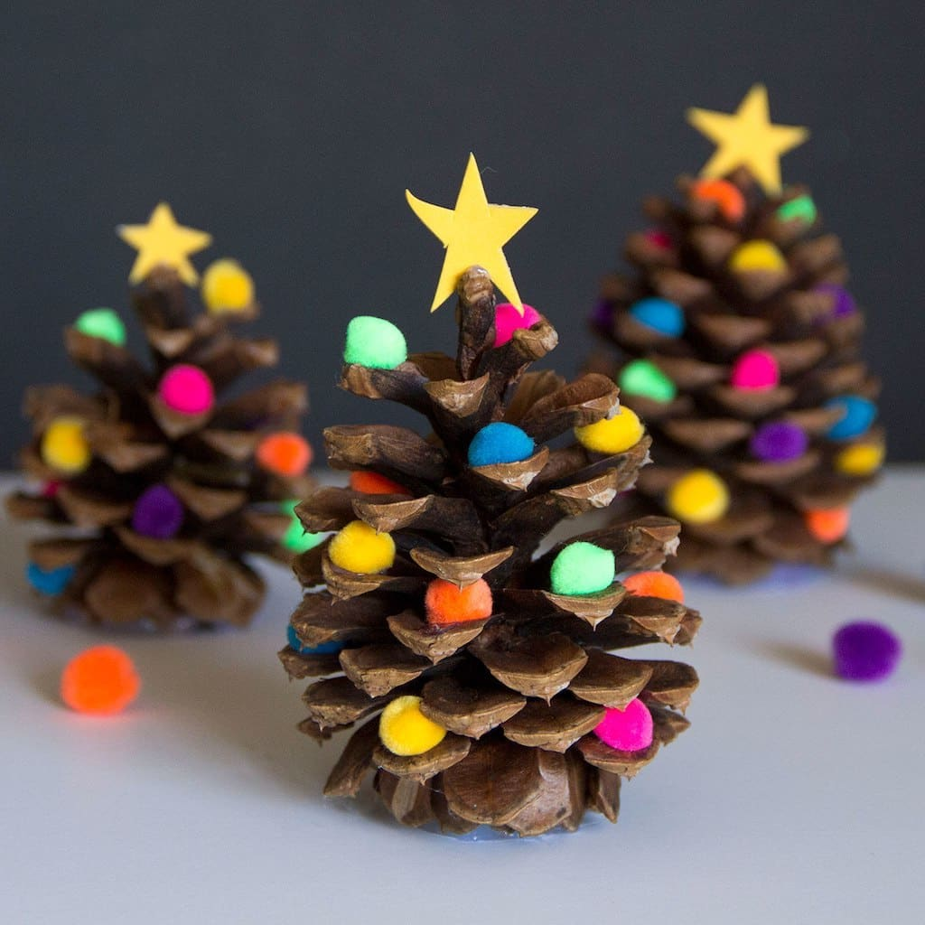 To diversify and decorate a miniature Christmas tree, you can use small soft balls for needlework