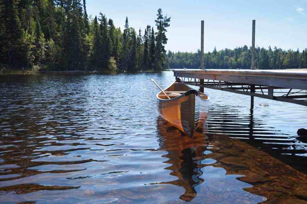 Backlit Canoe Tied to a Dock on a Northern Minnesota Lake