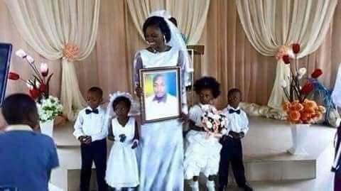 """""""She wanted marriage and she got it"""" – Reactions as lady gets married to photo of her lover in holy matrimony (Photos)"""