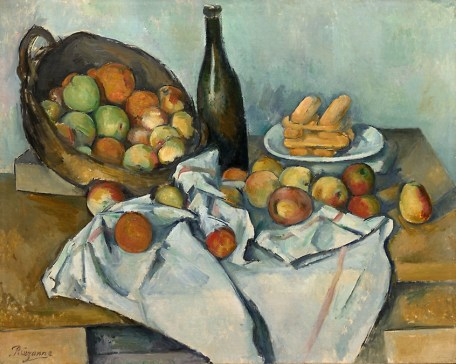 Still life painting of fruit, wine bottle, and bread on disheveled tablecloth. The Basket of Apples, c. 1893 Paul Cézanne