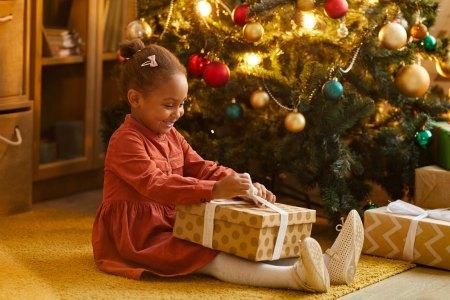 happy girl opening presents
