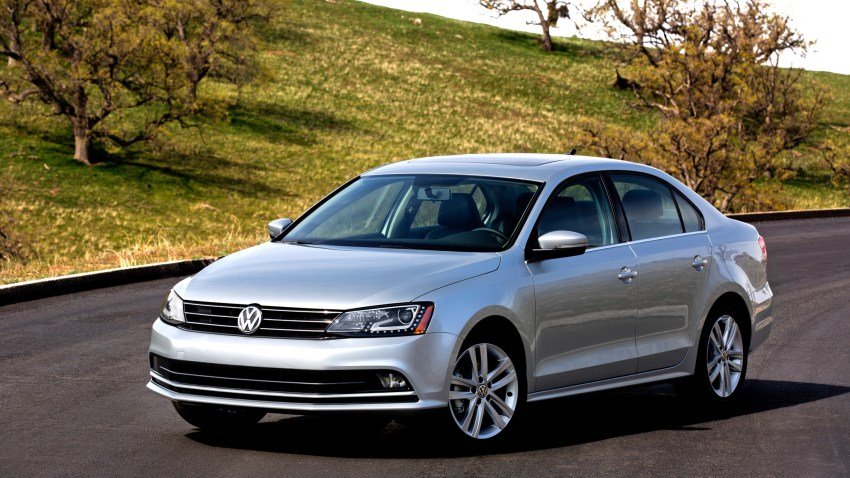 Photo of gray Jetta on road in the fall.
