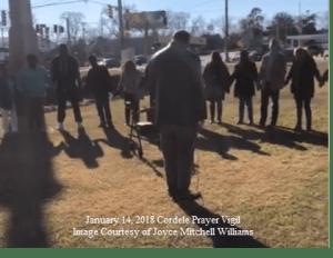 Community praying in Cordele, GA