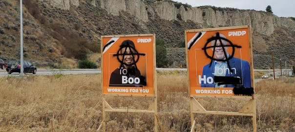 Two highway campaign signs were defaced with graffiti near our home