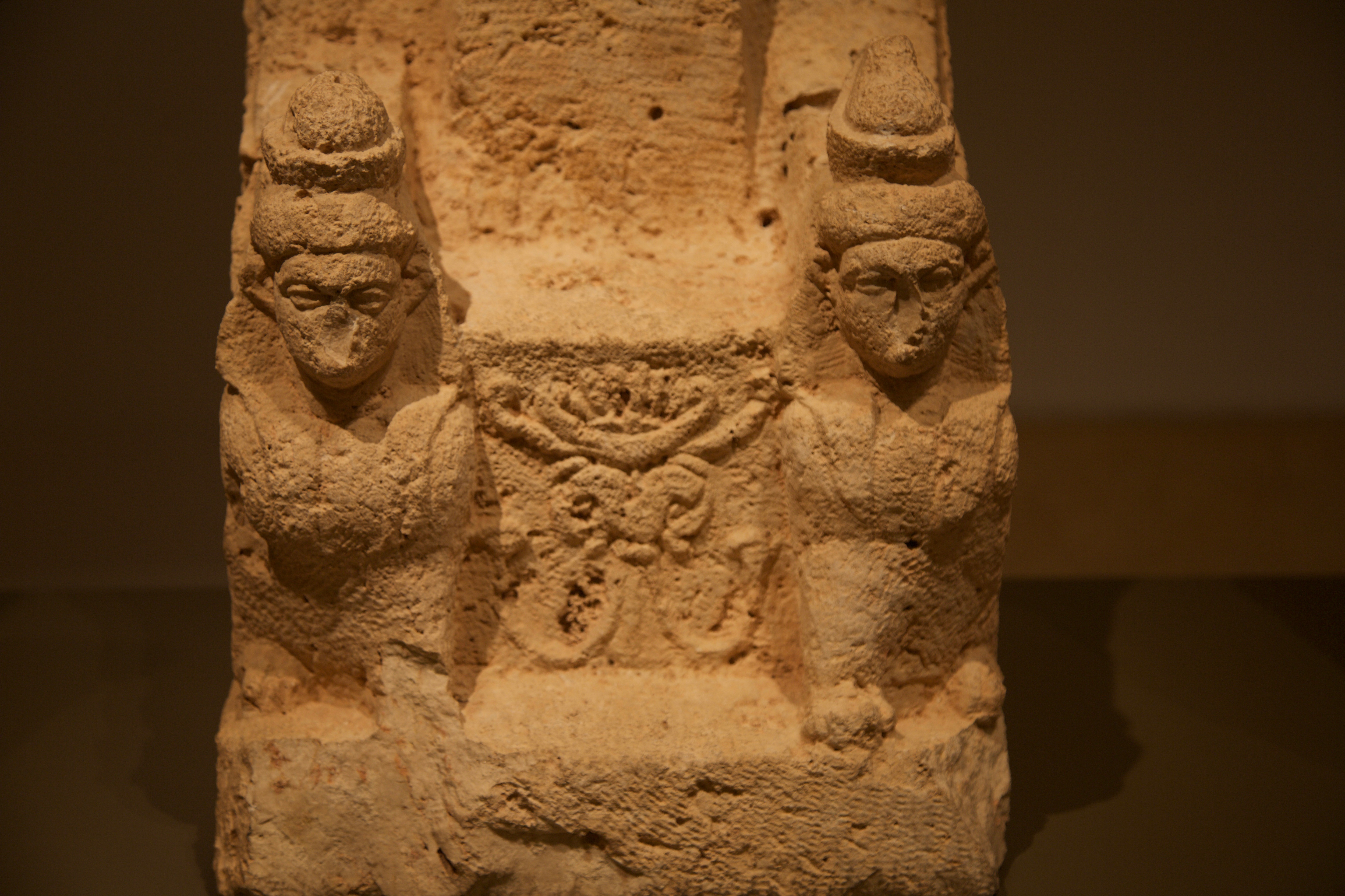 """Palm tree, tree of life, representing the fertility provided by Astarte. Situated between the two winged sphinx guarding her """"empty"""" throne. Close-up of winged sphinx. Hellenistic period. Don Michael Hudson, PhD National Museum of Beirut Beirut, Lebanon"""