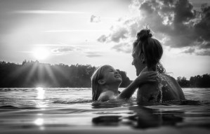Mother and daughter in lake