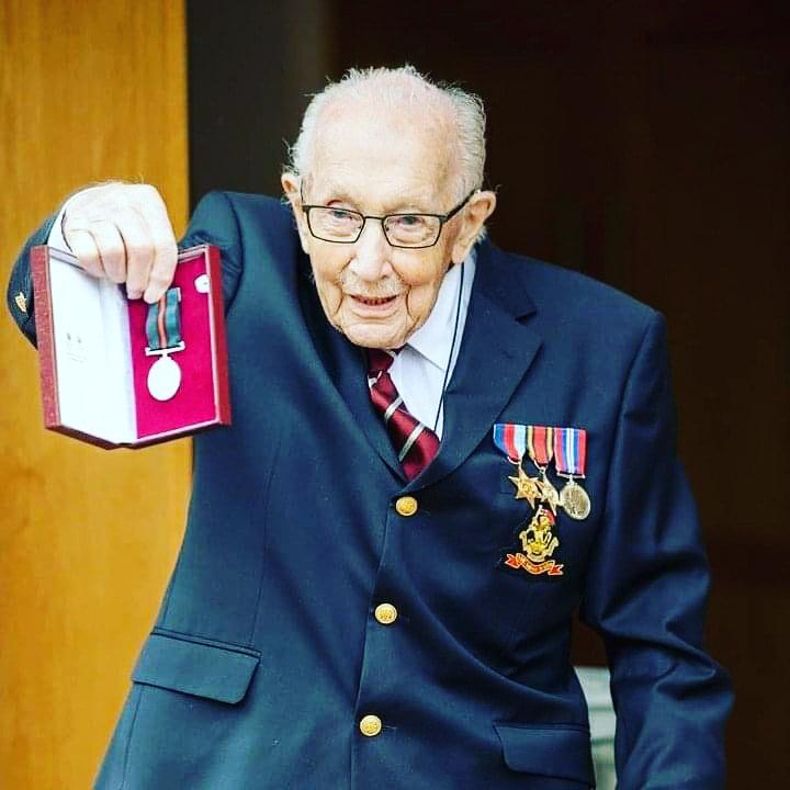 Captain tom holding medal