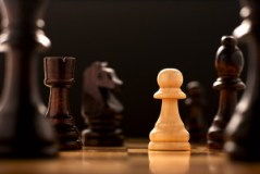 Pawn highlighted on a Chess Board representing solo entrepreneur in the game of life.