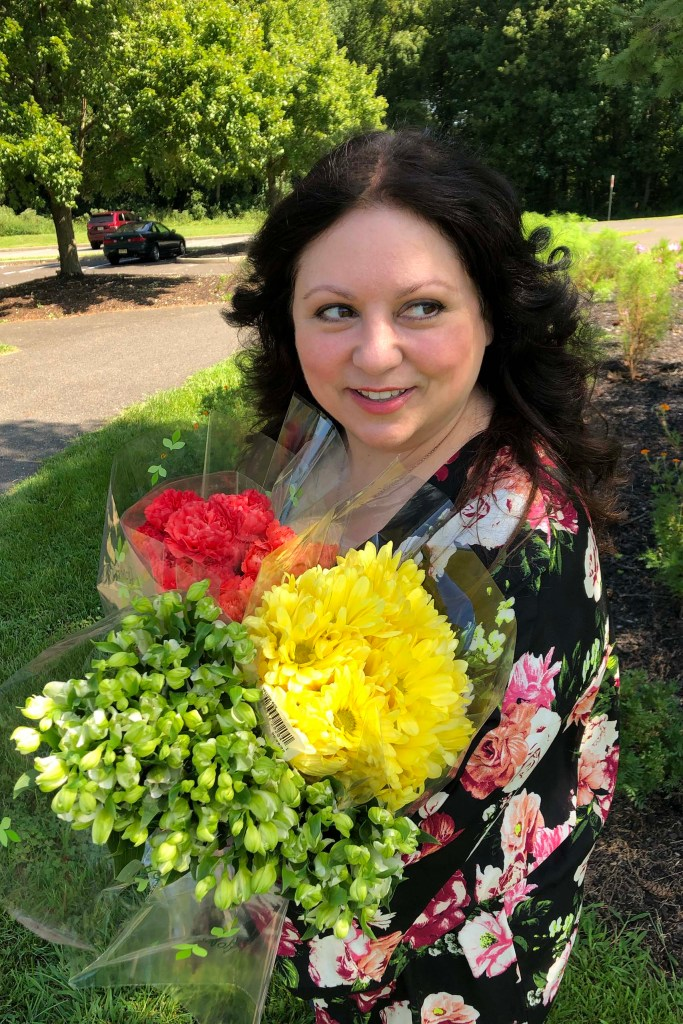 Donna DeRosa with flowers