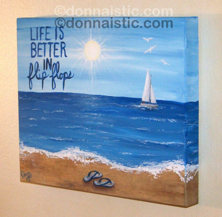 Life is Better in Flip Flops. A pair of flip flop sandals on the sand with a sailboat at the beach. Original Acrylic Painting by Donna Léger