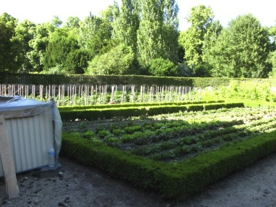 A kitchen garden behind a cottage in the Queen's Hamlet at Versailles in France. Photo by Donna L. Long, 2014. All rights reserved.