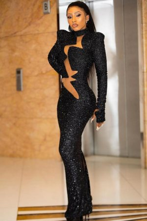 black sequin maxi dress with sheer midsection