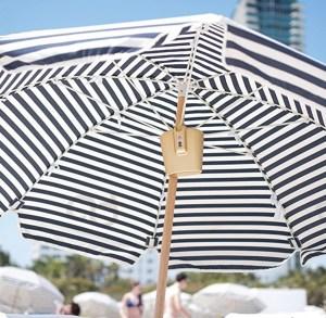 Beach safe attached to beach umbrella