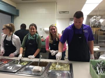 Me and some of my fellow classmates serving food at the North Iowa Food Kitchen.