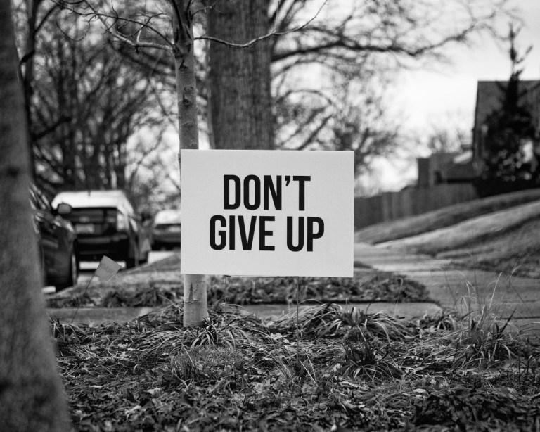 don't give up sign