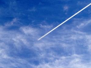 A white streak in cirrus blue sky