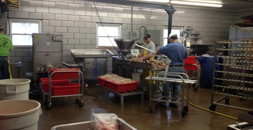 Employees making deer bologna