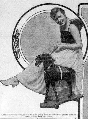 Newspaper Photo of Donna Montran sitting astride a wooden horse.