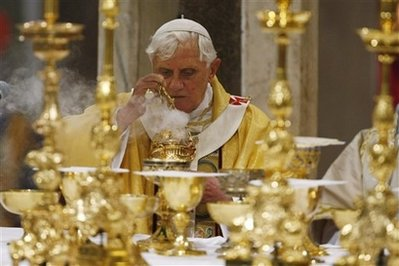 "Pope Benedict XVI burns incense at the altar as he celebrates the ""Cena Domini"" mass, which includes a feet-washing ceremony, in St. John in Lateran Basilica in Rome, Thursday April 9, 2009. The feet-washing ceremony symbolizes humility and commemorates Jesus' last supper with his 12 apostles on the evening before his Good Friday crucifixion. (AP Photo/Andrew Medichini)"