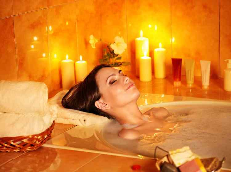 interior bath bathroom relax woman bubble bath candles