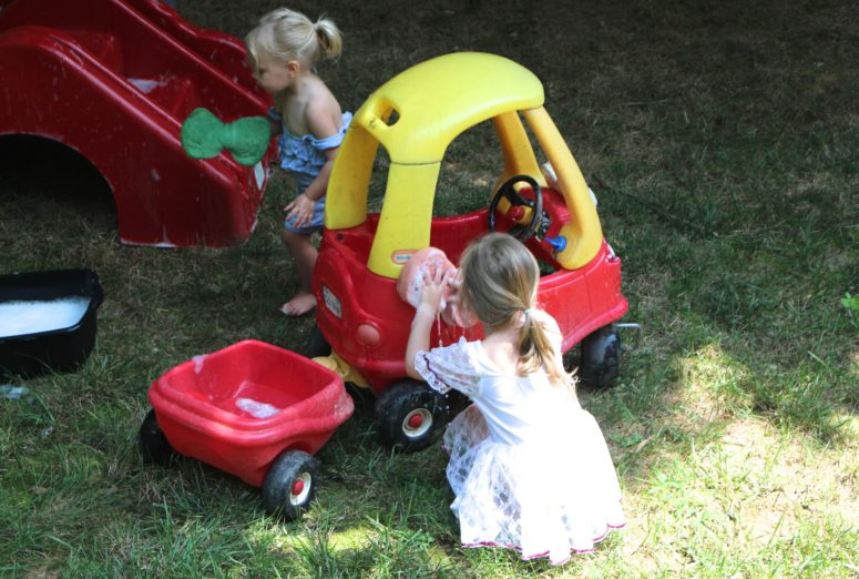 water activities - washing the little tikes car