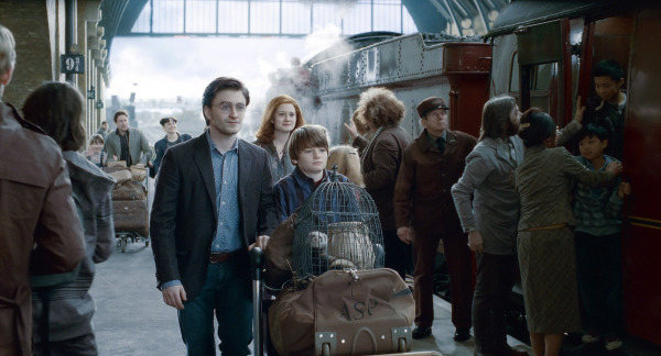 "SUNDAY CALENDAR AUGUST 7, 2011. DO NOT USE PRIOR TO PUBLICATION ******************** (L-r from center) DANIEL RADCLIFFE as Harry Potter, BONNIE WRIGHT as Ginny Weasley and ARTHUR BOWEN as Albus Severus Potter (19 years later)  in Warner Bros. Pictures' fantasy adventure movie  ""HARRY POTTER AND THE DEATHLY HALLOWS - PART 2,"" a Warner Bros. Pictures release. Photo courtesy of Warner Bros. Pictures"