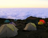 My favorite photo of the whole trek. We arrived in the dark but woke up to realise that we were above the cloud line. It was an amazing site.