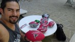 Dj Tialavea from the Atlanta Falcons pumps air into mini footballs before passing them out to children