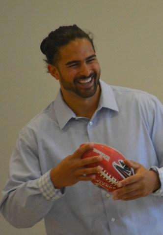 Dj Tialavea of the Atlanta Falcons speaking at West Jordan School 3