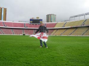Jonny Blair the travelling Northern Irishman standing on the pitch in Estadio Hernando Siles La Paz a lifestyle of travel