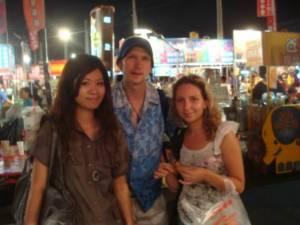 Jonny Blair Eva Jun and Natalja Tsumakova at a night market in Tainan, Taiwan