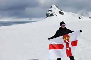 Backpacking Northern Ireland flag in Antarctica.