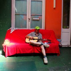 jonny blair playing guitar in montevideo uruguay