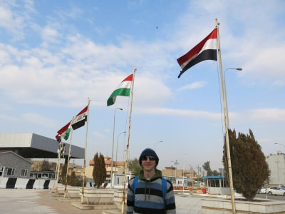 At the parliament in Erbil, Kurdistan and Iraq flags fly side by side.