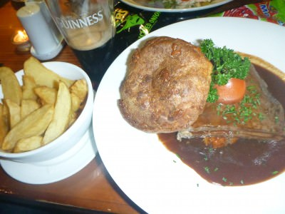 Beef, potatoes and Yorkshire pudding with chips on the side.