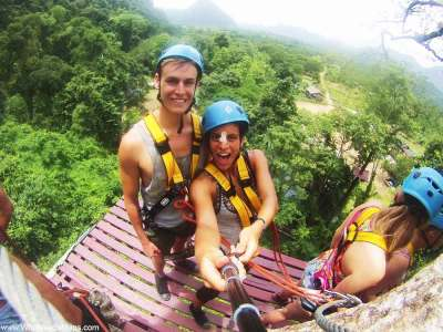 World Travellers: Jack and Jenn Zip-Lining in Laos.