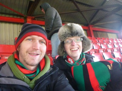 My friend Michael Whitford and I watching the Glens! Glentoran FC at the Oval in Belfast, Northern Ireland.