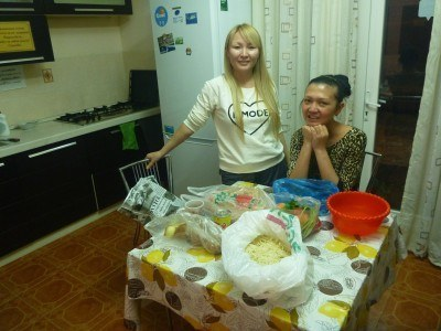 Rahat and Dinara in the kitchen getting ready for the Lagman