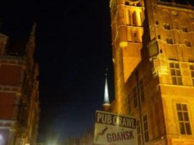 Pub Crawl Gdansk sign at Neptune's Fountain