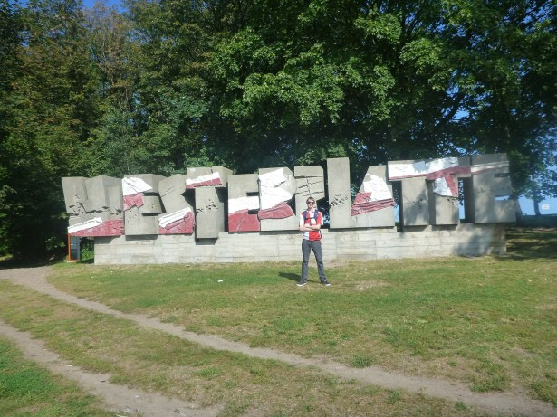 By the entrance sign at Westerplatte - we got off the bus here.