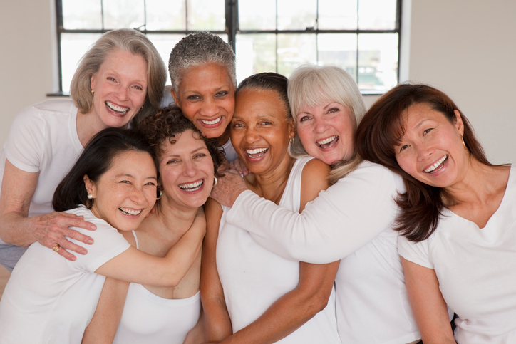 Diverse women hugging each other