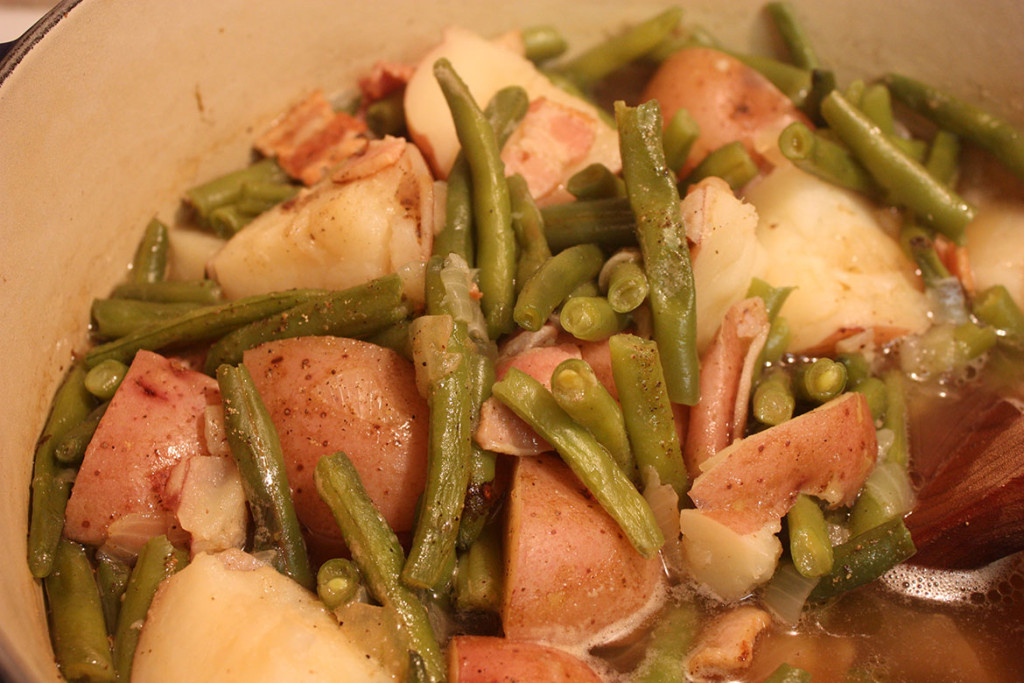 Southern Green Beans and Potatoes - A classic southern dish. Tender green beans and potatoes flavored with smoky bacon and onions.