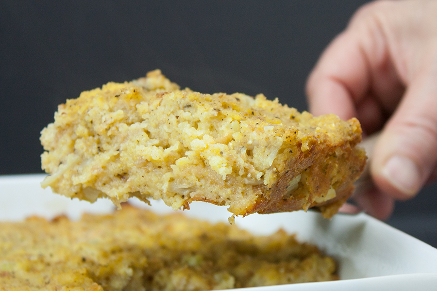 Southern Cornbread Dressing serving slice held up by spatula