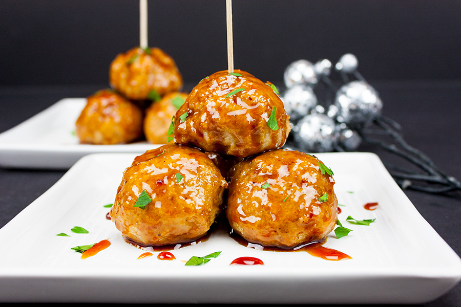 Firecracker Chicken Meatballs - Sweet, savory, and spicy all in one bite. Perfect for appetizers or main dish!
